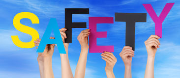 People Hands Holding Colorful Word Safety Blue Sky Stock Photography