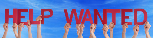 People Hands Holding Red Straight Word Help Wanted Blue Sky. Many Caucasian People And Hands Holding Red Straight Letters Or Characters Building The English Word Royalty Free Stock Images