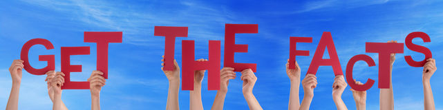 People Hands Holding Red Word Get The Facts Blue Sky. Many Caucasian People And Hands Holding Red Straight Letters Or Characters Building The English Word Get stock images
