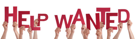 People Hands Holding Red Word Help Wanted Royalty Free Stock Image