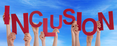 People Hands Holding Red Word Inclusion Blue Sky. Many Caucasian People And Hands Holding Red Letters Or Characters Building The English Word Inclusion On Blue Royalty Free Stock Image