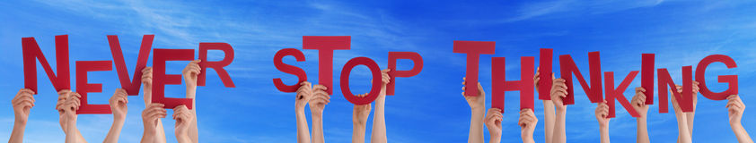 People Hands Holding Red Word Never Stop Thinking Blue Sky Stock Image