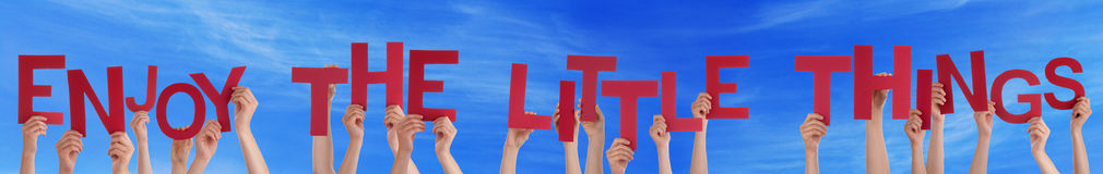People Hands Holding Word Enjoy The Little Things Blue Sky Stock Photo