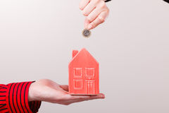 People hands with little house and silver coin. Royalty Free Stock Photos