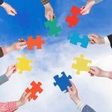 People hands with puzzle pieces with white cloud Stock Photos
