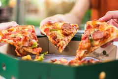People Hands Taking Slices Of Pizza Margherita. Pizza Margarita royalty free stock photos