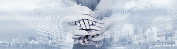 People hands together. Group of happy lucky young people hands over abstract background Stock Photography