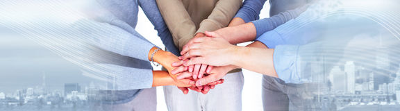 People hands together. Group of happy lucky young people hands over abstract background Royalty Free Stock Photo