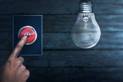 People hands turning off bulb light. Earth Hour Concept royalty free stock photography