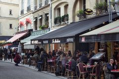 People hang out at cafes in Saint-Germain area Stock Photography