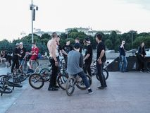 People hanging about, bikers gang hangout. Young boys hanging out at a skate place. Russia. Saint-Petersburg. Summer 2017 Stock Photography