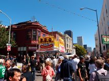 People hangout and walk around on street with BBQ booth at North stock image