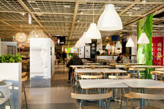 People have dinner in eatery space of the international IKEA store Stock Photos