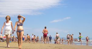 People Have Fun At Balearic Sea On Valencia Beach In Summer stock video footage
