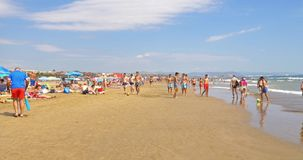 People Have Fun At Balearic Sea On Valencia Beach In Summer stock footage