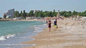 People Have Fun At The Black Sea Beach In Costinesti stock video