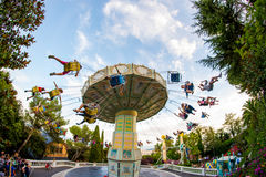 People have fun at the carousel flying swing ride attraction at Tibidabo Amusement Park Stock Photos