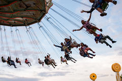People have fun at the carousel flying swing ride attraction at Tibidabo Amusement Park Stock Photo