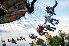 People have fun at the carousel flying swing ride attraction at Tibidabo Amusement Park Royalty Free Stock Photos