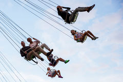 People have fun at the carousel flying swing ride attraction at Tibidabo Amusement Park Stock Images