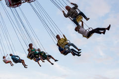 People have fun at the carousel flying swing ride attraction at Tibidabo Amusement Park Royalty Free Stock Photo