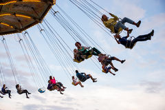 People have fun at the carousel flying swing ride attraction at Tibidabo Amusement Park Stock Photography