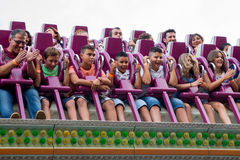 People have fun at the Drop Tower attraction at Tibidabo Amusement Park Royalty Free Stock Photography