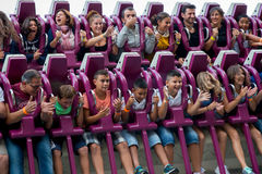 People have fun at the Drop Tower attraction at Tibidabo Amusement Park Royalty Free Stock Image