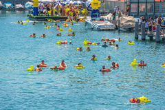 People have fun participating the swimming summer festival Stock Images