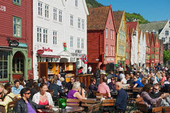 People have lunch at street restaurants at Bruggen in Bergen, Norway. Royalty Free Stock Photography