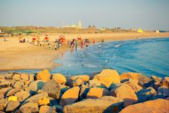 People have a rest on ocean shore in Somnath stock photo