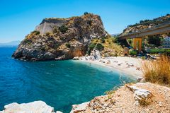People have a rest at sea bay of Palaiokastro town with beautiful beach on Crete island, Greec Royalty Free Stock Photo