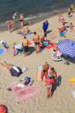 People have a rest in the summer on the sandy coast of the Baltic Sea Royalty Free Stock Photography