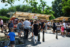 People have a snack at the Street Food Festival in central park Cluj. Stock Image