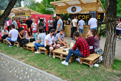 People have a snack at the Street Food Festival in central park Cluj. Stock Images