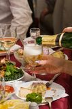 People have supper on a banquet. People have supper, drink drinks. Restaurant Royalty Free Stock Photos