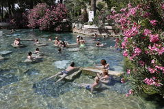 People having bath in Cleopatra's thermal pool of Hierapolis Stock Images