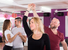 People having dancing class. Happy young males and females  having dancing class indoors Stock Photos