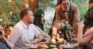 People having dinner in garden stock footage
