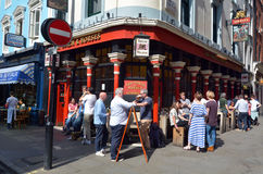 People having a drink outside English bar in the Soho, London UK Royalty Free Stock Photos