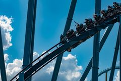 People having fun amazing Mako rollercoaster on lightblue cloudy sky background at  Seaworld 6. Orlando, Florida. April 26, 2019. People having fun amazing Mako stock images