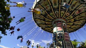 People having fun at an amusement park stock footage