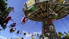 People having fun at an amusement park stock footage