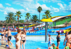 People having fun in aqua park. Blurred image Royalty Free Stock Images