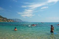 People having fun on the beach. People having fun on the Copacabana beach in Montenegro Royalty Free Stock Image