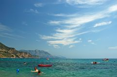 People having fun on the beach. People having fun on the Copacabana beach in Montenegro Royalty Free Stock Photography