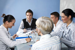 People having fun at business meeting. Group of five people having fun and laughing at business meeting on blue background,check also stock images