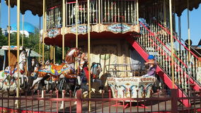 People having fun at Carousel Merry Go Round stock footage