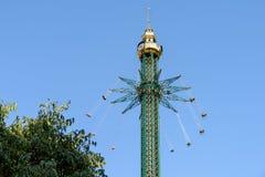 People Having Fun In Carousel Swing Ride Royalty Free Stock Image