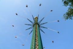 People Having Fun In Carousel Swing Ride Stock Photography